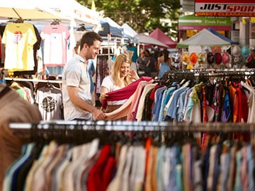 Couple walk through The Valley Markets