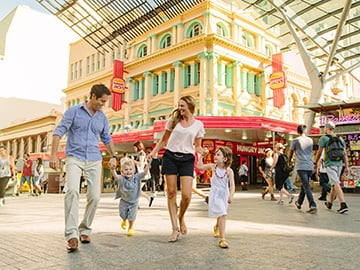 Kids with parents in Queen Street Mall