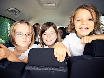Kids sitting in a car