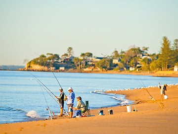 Men fishing on beach